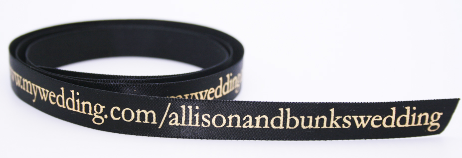 Personalized satin ribbon with wedding website URL.