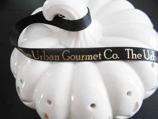 Personalized black satin ribbon with gold metallic foil.
