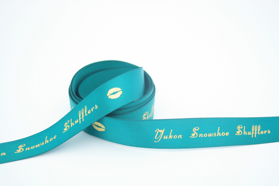 Personalized satin ribbon with gold foil.